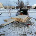 Loading lumber in the snow.